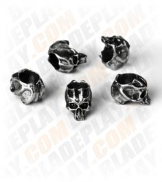"""Schmuckatelli Pewter Mini Cyber Skull Lanyard Beads (Set of 5)    The Joe Skull Beads are made of pewter and each measure 1/4"""" (width) x 3/8"""" (height) x 3/8"""" (depth) with a 3/16"""" diameter hole. The Schmuckatelli lanyard bead is just the way to dress up your knives and gear. Be sure to click on the pictures above for a larger, detailed look at this cool skull bead.  Sold in sets of 5. $11.99"""