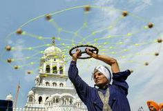 23 May 2014 An Indian Nihang - religious Sikh warrior - shows off his skills in the Sikh martial art known as 'Gatka' during a procession fr...