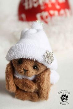 This is adorableness wrapped up in carmel colored fur and a white fuzzy snow cap.  Mocco by Lastenka on Etsy, $75.00