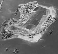 Aerial view looking south at Ford Island, Pearl Harbor, US Territory of Hawaii, 30 Oct 1941; note partial view of Battleship Row at left and...