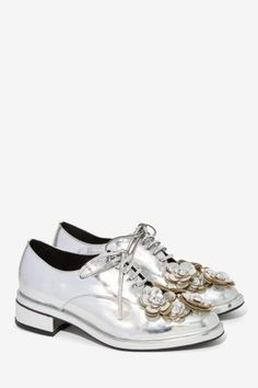 With a metallic floral shine, these oxfords will light up your smile. $135.00