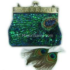 peacock bag; already have the earring @Abby Self