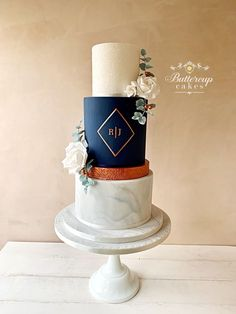 Contemporary wedding cake in Navy blue, with copper accents and beautiful white sugar roses. #navybluewedding #navyblueweddingcake #modernweddingcake  #marbleweddingcake #contemporaryweddingcake #cheshireweddingcakes Copper Wedding Cake, Navy Blue Wedding Cakes, White And Gold Wedding Cake, Elegant Wedding Cakes, Beautiful Wedding Cakes, Wedding Cake Designs, Elegant Cakes, Purple Wedding, Lace Wedding