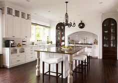 Caden Design Group. Traditional Kitchen. Love the dark wood contrast, the built ins with arches.