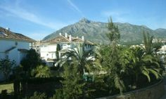 Luxury apartments in Marbella with La Concha mountains in the background.