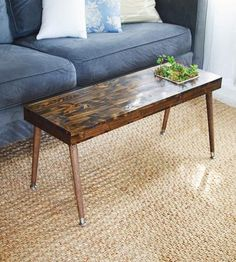 Spruce up your living room with this handmade table, which features a built-in planter box. Finished in your choice of stain color, the wood tabletop has a recessed planter off to one side for building your own miniature garden. Even better, some choice succulents are already included to get your garden party started. The long rectangular shape can be used as a coffee table, side table or even a bench, to best suit your space.