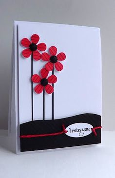 handmade card ... clean design ... black and white with a pop of red ...  luv this trio of long stemmed flowers ... scored petals ...