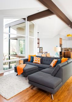 Interesting View by Grey Sofas with Blue and Yellow Pillows Facing Fur Rug in White Color