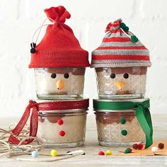 Did you know you can bake jars? You can -- and that's exactly how these little snowmen came to be, filled with delicious mini brownie cheesecakes (link to recipe is below). Once the cheesecakes cool, place the lids on the jars. Cut the toe from one baby sock, and wrap the cut end with twine. Glue pom-poms on each end of the twine. Slide the sock hat over the top jar. Make a cone with a piece of orange construction paper for the nose and glue to the jar, along with two black pom-poms for…