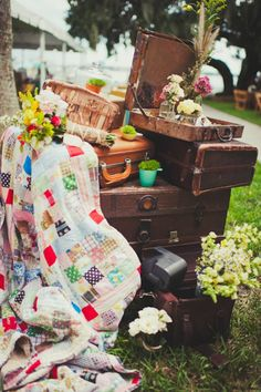 Love the quilt and Vintage trunks and suitcases. #RePurpose