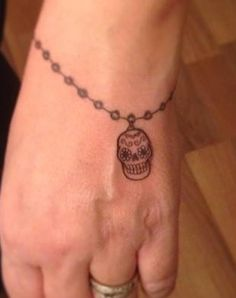 My tiny sugar skull bracelet by Inzane Artworks, it is perfect!