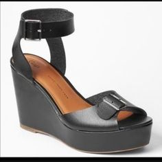 "NWOT Gap genuine leather buckle wedge sandals New without tags. Soooo cute on. Easy to walk in. Black leather. Silver tone accents on buckles. Wedge is 4"". Must have basic!! Never worn. GAP Shoes Wedges"