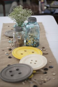 Cute As a Button #babyshower theme - adore these over-sized buttons as table decor