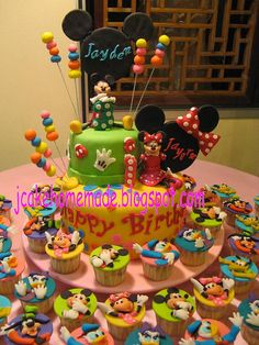 Mickey Mouse and Minnie Mouse cake and cupcake by Jcakehomemade, via Flickr