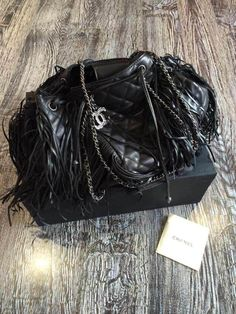 Ms Fashion Junkie - Chanel Black Quilted Leather Bag with Fringes Metiers d' Art Paris-Dallas 2014, Black, $725.00 (http://www.mrsfashionjunkie.com/chanel-black-quilted-leather-bag-with-fringes-metiers-d-art-paris-dallas-2014-black/)