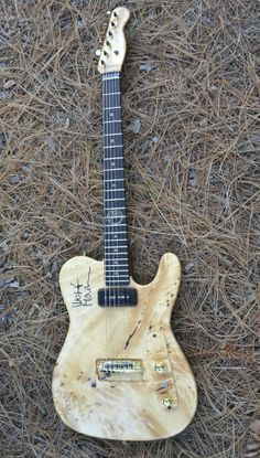 Mark Gilbert Guitars - Wolf Mail Hybrid. Highly gured Huon Pine cap on body. (This wood has been estimated as up to 2.000 years old – hence Wolf calling it B.C.) Wolf Mail signature inlay.