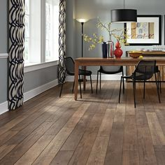 "Restoration 6"" x 51"" x 12mm Treeline Oak Laminate Flooring in Fall"
