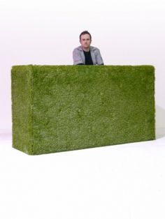 This is a great idea to cover up a bar at your event, use artificial grass and you have a giant hedge.