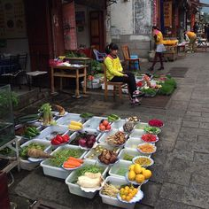 Market day in Dali #YunnanProvince. All of the restaurants on the main market street displayed the fresh produce they were serving on the street in plastic tubs. Artfully organizing: dragon fly larvae eels mushrooms of all sorts local vegetables and fruits. #marketdayDali #Dali #colorsofchina #cnttakeover @gtowey by cntraveler