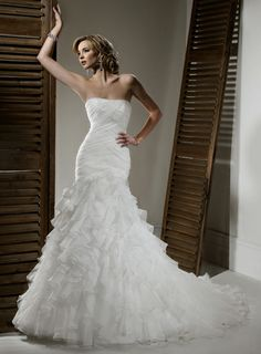 A-line Strapless Chapel Train Charming Tulle with Ruffle wedding dress