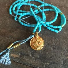 BABY TURQUOISE GANESH MALA (LAKSHMI ON BACK SIDE)  Solid 18K Yellow Gold w/ Grade AA Navajo Turquoise (available on red thread)  This is the MANIFESTATION & EXPANSION MALA. Perfect layering piece. Limited stock. Unisex.   Turquoise is the stone of wholeness + truth, known as one of the strongest expression stones in the mineral kingdom. It is also one of the strongest protection stones worn by tribes for centuries to protect on the journey.  #Lakshmi #shaktijewelry  www.iloveshakti.com