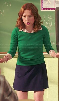 I love this whole outfit: Kimmy's green sweater, flamingo print shirt and navy wrap skirt on Unbreakable Kimmy Schmidt.  Outfit Details: http://wornontv.net/46613/ #UnbreakableKimmySchmidt