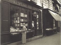 Vintage Photos of Bygone Bookstores. Sylvia Beach in the window of the famous Shakespeare and Company, Paris, 1939. Image by Gisèle Freund.