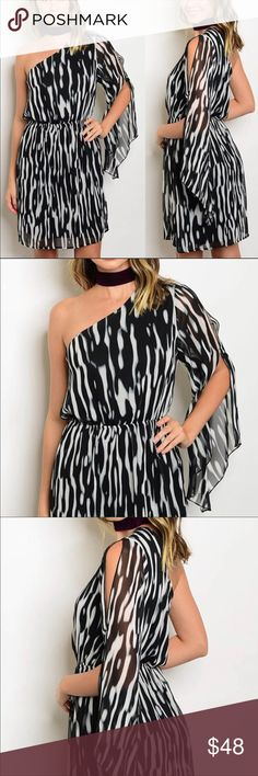 Black & White Print One Flutter Sleeve Dress Fun, stylish black and white print dress. Lined underneath. 100% Polyester. Glamvault Dresses Mini