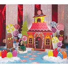okay...this is ugly, but idea of doing a large gingerbread house (blackboard style, but with COLOR trim etc) and oversized candy cane lollipops that people could be holding and a gingerbread man OUTLINE that a person can get 'in'