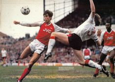 11th March 1989. Nottingham Forest full back Stuart Pearce flying out to block a shot from Arsenal striker Alan Smith, at Highbury.