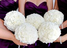 Bridesmaids with white hydrangea bouquets