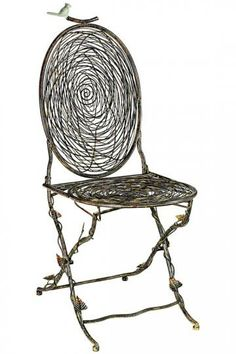 The Nest Folding Chair is expertly designed to look like intertwined twigs, but is actually crafted of solid iron. Perfect for both indoor and outdoor locations, this charming chair will add charming personality to your space.