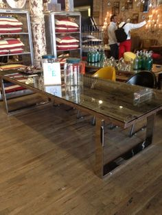 cool dining table. under glass is reclaimed wood.