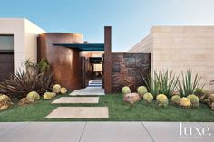 Visitors are welcomed by Elemental Harmony, a large bronze art piece by Los Angeles-based sculptor Malcolm Susman. A variety of drought-resistant succulent plants, added by landscape architect David A. Pedersen of Newport Beach, complement the home's contemporary architecture.