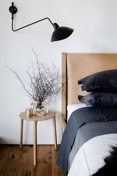 Each arm extends from a fixed-length down rod assembly and varies in length, allowing light to be distributed throughout the room. The tiltable heads can articulate up and down in a 270° rotation. Trendy Bedroom, Modern Bedroom, Bedroom Black, Contemporary Bedroom, Modern Wall, Leather Headboard, Leather Bed Frame, Ideas Hogar, Black Walls