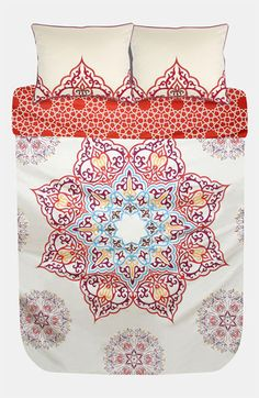 """Blissliving Home Chanda Duvet Set: """"Intricate mandalas cover a sateen duvet cover that reverses to an interlaced, citrus side for a totally different look. Two coordinating shams with beautiful embroidery finish off the Far-East inspired bed set."""""""