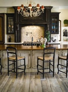 Like the rustic floors and contrasting cabinets/countertops/hood