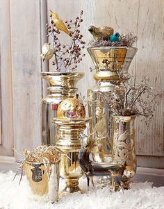 Gold Display:   Use gently damaged vintage ornaments — like the birds in a tinsel nest, which lack the parts to clip to a branch — in tabletop displays.   Photo Credit: Jim Bastardo
