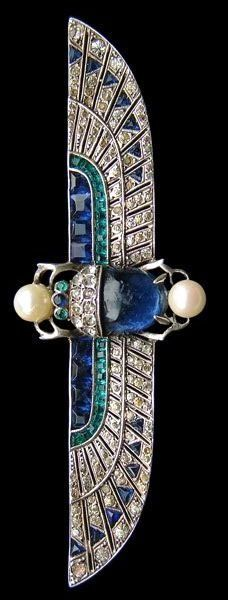 Egyptian motif brooch - Sapphire, emerald, pearl set in white gold. Knoll & Pregizer http://www.slideshare.net/CharlesITaylor/women-diamond-watches-beautiful-best-diamond-watches