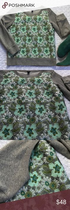 "J CREW GREEN SPARKLE SWEATSHIRT Grey sweatshirt with many green colors and silver metallic. Makes such a pretty statement piece all on it's on. Bust 18"" Length 21.5"". -No trades. 100% cotton base. Front Panel: 49% Wool 20% Cotton 16% Nylon 10% Silk 5% Metallic J. Crew Tops Sweatshirts & Hoodies"