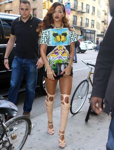 Yep, the Winter staple can channel a summery vibe too. Rihanna pulled it off with light and bright Summer colours and by keeping thighs and arms bare.