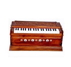 Harmonium2 This beautiful musical instrument made up of teak wood offers you horizontal reed board 9 stoppers and is 3 ½ octaves. Start your musical voyage with this beauty.
