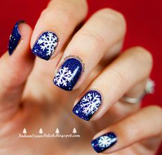 Navy blue and white snowflake nails