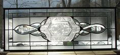This stained glass panel uses one of my favorite vintage crystal plate patterns as the centerpiece. This unique plate was created in the