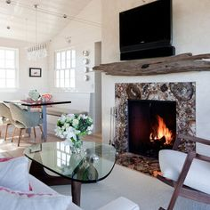 Huge piece of driftwood for a fireplace mantle.  Contemporary Home Modern Beach House Decor Design,