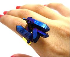 I'm not sure how to describe this ring; it's pretty, and a deep blue, with blue crystals attached to the ring