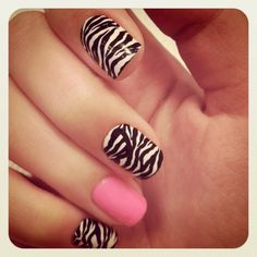 Zebra Print nails & my thumb would be Pink. Cause I'm an odd ball & have to have my thumb nail a different color. :P