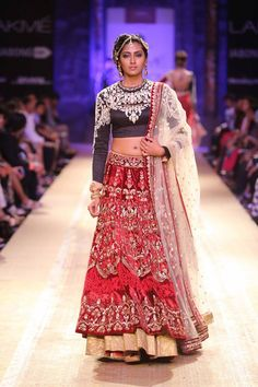 Black red and gold Indian bridal lehenga by Anju Modi at Lakme Fashion Week Winter 2014. More here: http://www.indianweddingsite.com/lakme-fashion-week-winter-2014-anju-modi-collection/