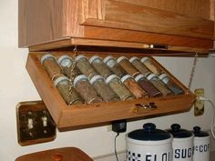 Build a fold out spice rack. | 44 Cheap And Easy Ways To Organize Your RV/Camper