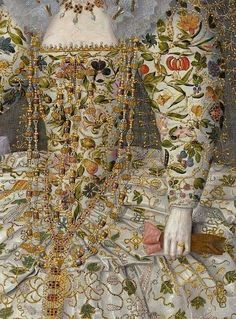 detail of painting by Richard Peake, c. Portrait of Catherine Carey, Countess of Nottingham. Gown with crewel style embroidery. Note the very long gold and crystal necklace and what appears to be a pair of pink leather gloves. Rosa Tudor, Marie Meyer, Estilo Tudor, Motifs Textiles, Tudor Black Bay, Elizabethan Era, Tudor Era, Tudor Style, Elizabeth I